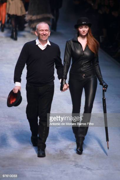 Designer JeanPaul Gaultier and model Lily Cole walk the runway at the end of the Hermes Ready to Wear show as part of the Paris Womenswear Fashion...