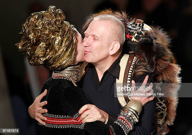Designer JeanPaul Gaultier and model Sasha Pivovarova greet each other on the runway at the end of the JeanPaul Gaultier Ready to Wear show as part...