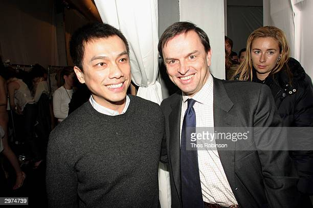 Designer Jeffrey Chow greets President and CEO Cartier Stanislad de Quercize backstage at the Jeffrey Chow Fall 2004 during Olympus Fashion Week...