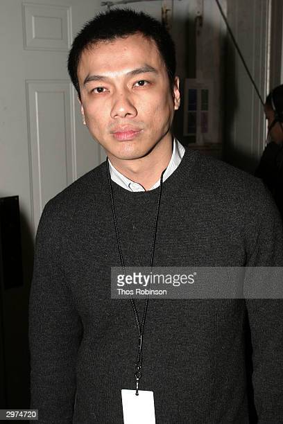 Designer Jeffrey Chow stands backstage at the Jeffrey Chow Fall 2004 during Olympus Fashion Week February 12 2004 in New York City