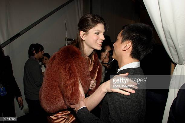 Designer Jeffrey Chow talks with a model backstage at the Jeffrey Chow Fall 2004 during Olympus Fashion Week February 12 2004 in New York City