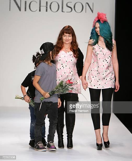 Designer Jennifer Nicholson her sons and a model walk the runway at the Jennifer Nicholson Spring 2007 fashion show during Mercedes Benz Fashion Week...