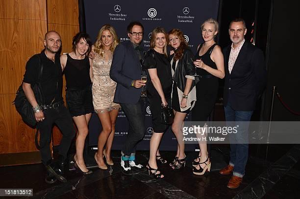 Designer Jenny Packham poses with her New York Fashion Week runway team during Spring 2013 MercedesBenz Fashion Week at the Stone Rose Lounge on...