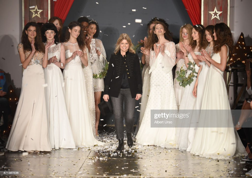 Designer Jenny Packham walks the runway with models at the Jenny Packham show during New York Fashion Week: Bridal on April 21, 2017 in New York City.