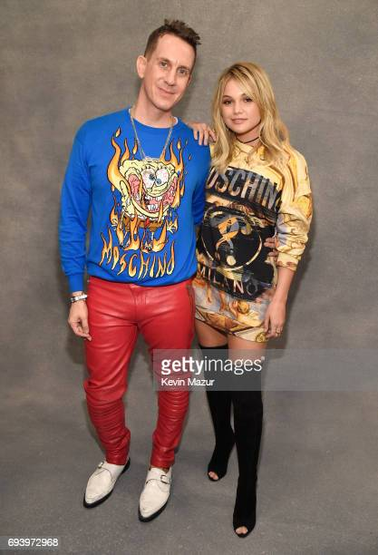 Designer Jeremy Scott and actor Olivia Holt pose backstage at Moschino Spring/Summer 18 Menswear and Women's Resort Collection at Milk Studios on...