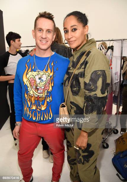 Designer Jeremy Scott and actor Tracee Ellis Ross pose backstage at Moschino Spring/Summer18 Menswear and Women's Resort Collection at Milk Studios...