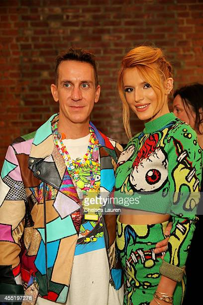 Designer Jeremy Scott and Bella Thorne pose baskstage at Jeremy Scott fashion show during MADE Fashion Week Spring 2015 at Milk Studios on September...
