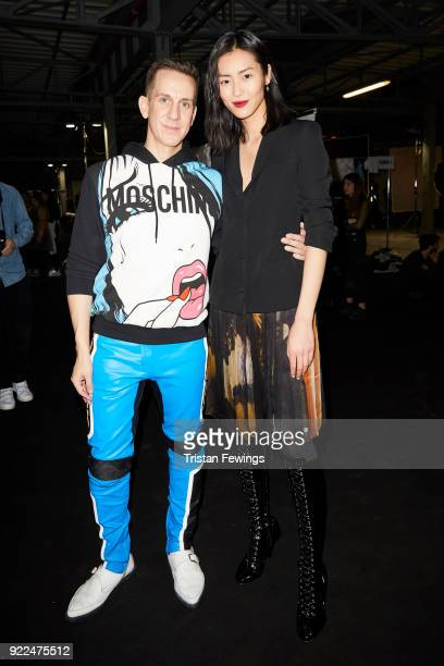 Designer Jeremy Scott and Liu Wen are seen backstage ahead of the Moschino show during Milan Fashion Week Fall/Winter 2018/19 on February 21, 2018 in...