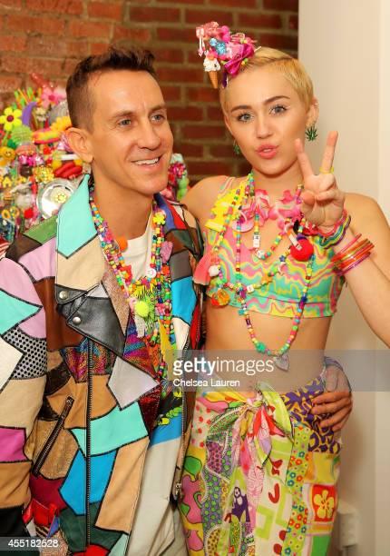 Designer Jeremy Scott and Miley Cyrus pose baskstage at Jeremy Scott fashion show during MADE Fashion Week Spring 2015 at Milk Studios on September...