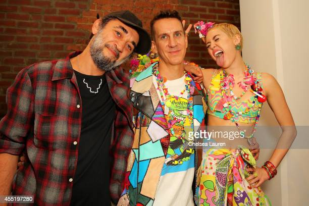 Designer Jeremy Scott and Miley Cyrus pose baskstage at Jeremy Scott fashion show during MADE Fashion Week Spring 2015 at Milk Studios on September...