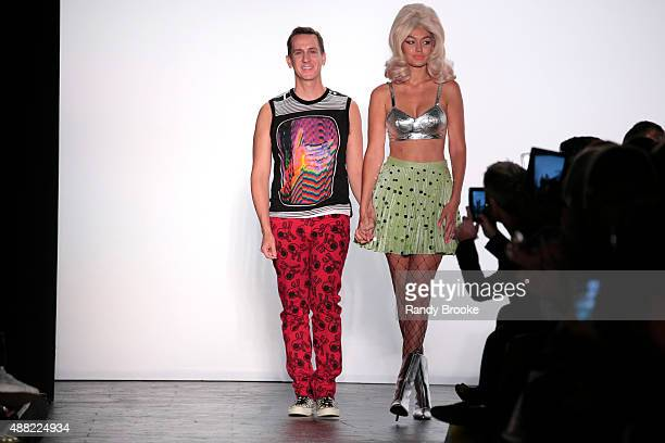 Designer Jeremy Scott and model Gigi Hadid greet the audience at the finale of the Jeremy Scott Runway Spring 2016 New York Fashion Week: The Showsat...