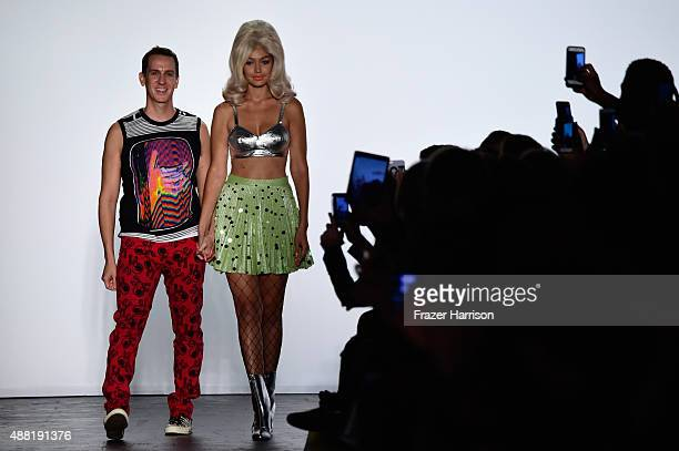 Designer Jeremy Scott and model Gigi Hadid walk the runway wearing Jeremy Scott Spring 2016 during New York Fashion Week: The Shows at The Arc,...