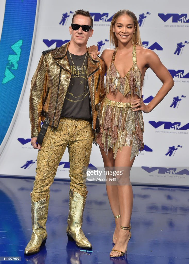 Designer Jeremy Scott and model Jasmine Sanders arrive at the 2017 MTV Video Music Awards at The Forum on August 27, 2017 in Inglewood, California.