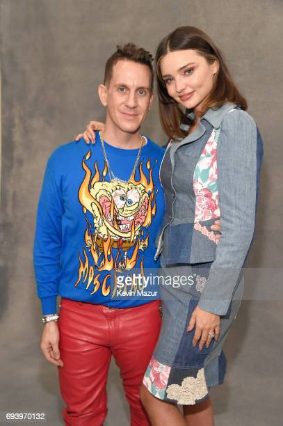 Designer Jeremy Scott and model Miranda Kerr pose backstage at Moschino Spring/Summer 18 Menswear and Women's Resort Collection at Milk Studios on...