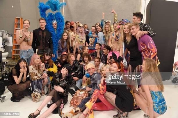 Designer Jeremy Scott and models pose backstage at Moschino Spring/Summer 18 Menswear and Women's Resort Collection at Milk Studios on June 8 2017 in...