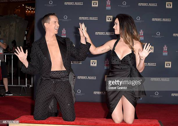 Designer Jeremy Scott and Singer Katy Perry are honored during their hand print ceremony at TCL Chinese Theatre IMAX Forecourt on September 8 2015 in...
