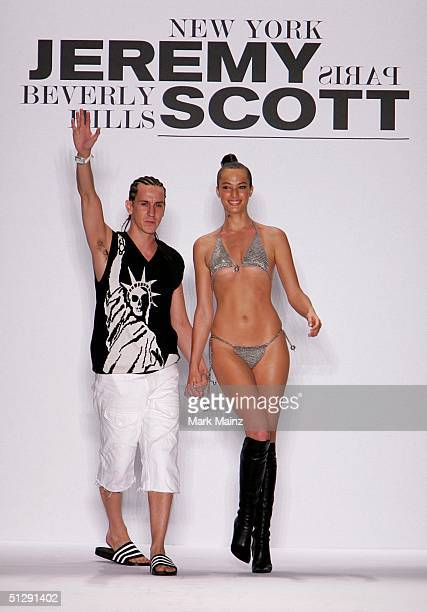 Designer Jeremy Scott closes the runway at the Jeremy Scott show during Olympus Fashion Week Spring 2005 in Bryant Park September 11 2004 in New York...