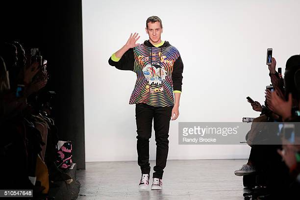 Designer Jeremy Scott greets the audience at the runway finale during the Jeremy Scott fashion show at The Arc Skylight at Moynihan Station on...