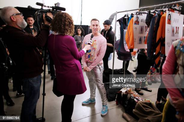 Designer Jeremy Scott is interviewed backstage for Jeremy Scott during New York Fashion Week The Shows at Gallery I at Spring Studios on February 8...