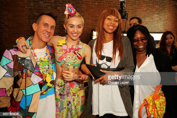Designer Jeremy Scott Miley Cyrus Jerzey Dean and Whoopi Goldberg pose baskstage at Jeremy Scott fashion show during MADE Fashion Week Spring 2015 at...