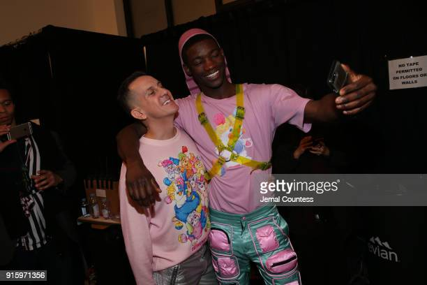 Designer Jeremy Scott poses with a model backstage for Jeremy Scott during New York Fashion Week The Shows at Gallery I at Spring Studios on February...