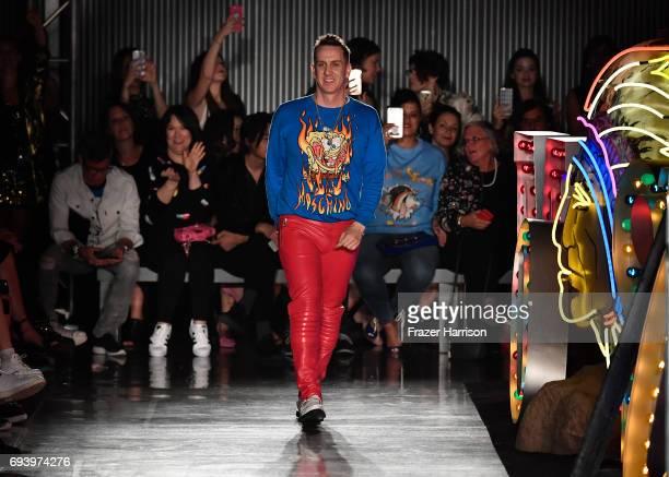 Designer Jeremy Scott walks the runway at Moschino Spring/Summer 18 Menswear and Women's Resort Collection at Milk Studios on June 8 2017 in...