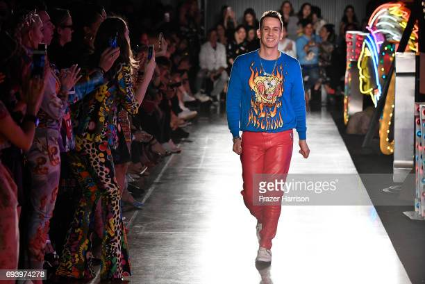 Designer Jeremy Scott walks the runway at Moschino Spring/Summer 18 Menswear and Women's Resort Collection at Milk Studios on June 8 2017 in...