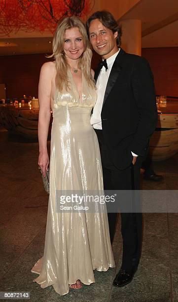 Designer Jette Joop and friend Christian Elsen attend the Innocence in Danger Art for Children charity gala at the Hyatt hotel April 26 2008 in...