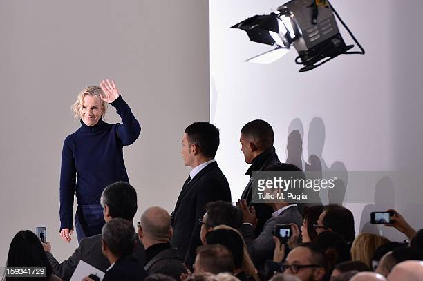 Designer Jil Sander acknowledges the applause of the audience after the the Jil Sander show as part of Milan Fashion Week Menswear Autumn/Winter 2013...