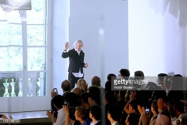Designer Jil Sander acknowledges the applause of the audience after the Jil Sander show during Milan Menswear Fashion Week Spring Summer 2014 on June...