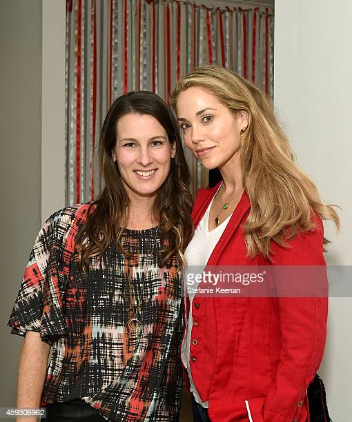 Designer Jill Smith and actress Elizabeth Berkley attend the Baby2Baby Nutcracker Party Presented By Tiny Prints on November 20 2014 in Los Angeles...