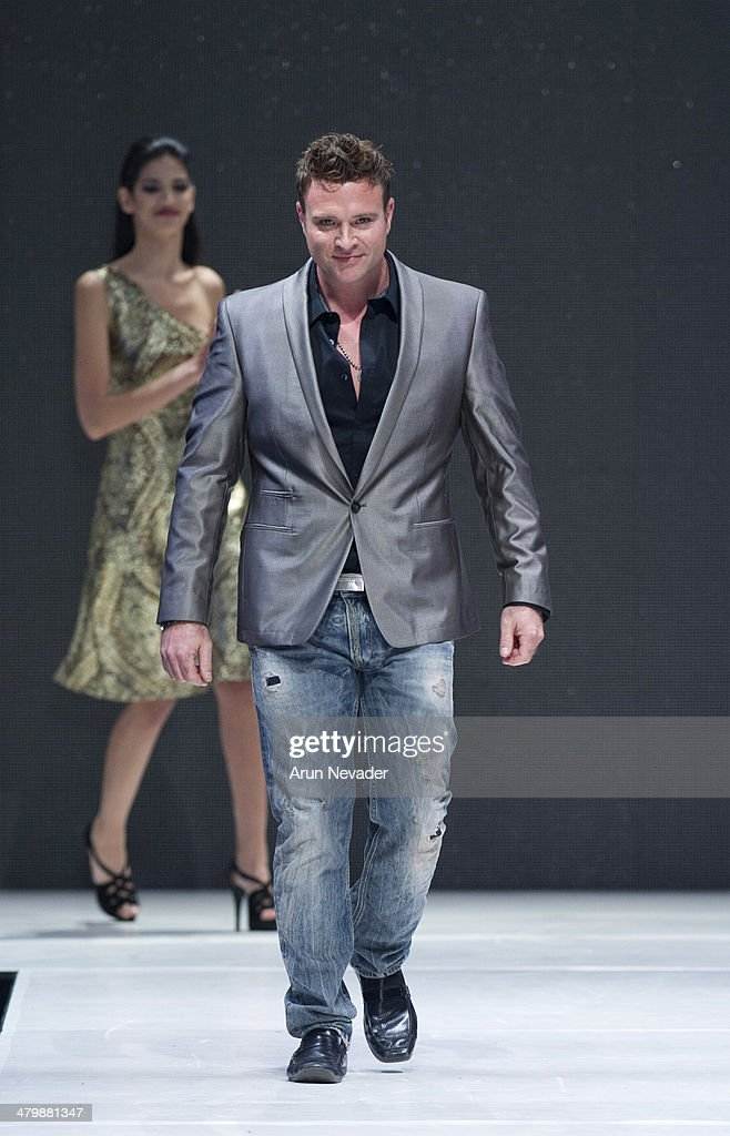 Designer Jim Mullins appears on the runway during the JM Couture fashion show at El Paseo Fashion Week 2014 on March 20, 2014 in Palm Desert, California.