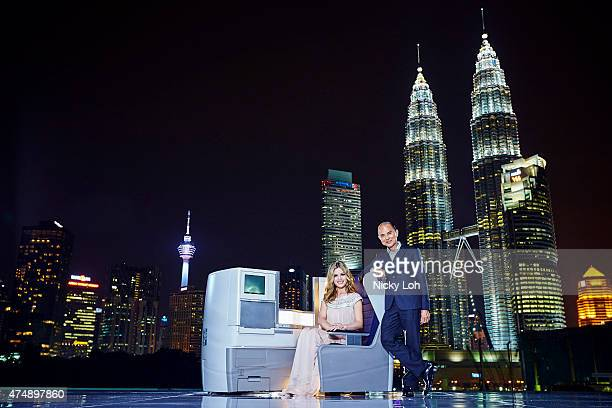 Designer Jimmy Choo , actress Georgia May Jagger pose with a British Airways' Club World seat in front of the Petronas Twin Towers to mark the first...
