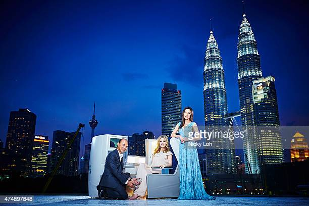 Designer Jimmy Choo , actress Michelle Yeoh and supermodel Georgia May Jagger pose with a British Airways' Club World seat in front of the Petronas...
