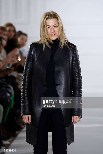 Designer Joanna Sykes appears on the runway after the Aquascutum show at London Fashion Week Autumn/Winter 2012 at The Savoy Hotel on February 18...