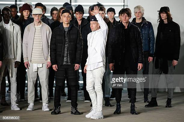 Designer John Elliott waves to the audience at the conclusion of his John Elliott + CO show during NYFW Men's F/W 2016 at Skylight at Clarkson Sq on...