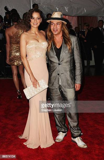Designer John Galliano and actress Marion Cotillard attends 'The Model as Muse Embodying Fashion' Costume Institute Gala at The Metropolitan Museum...
