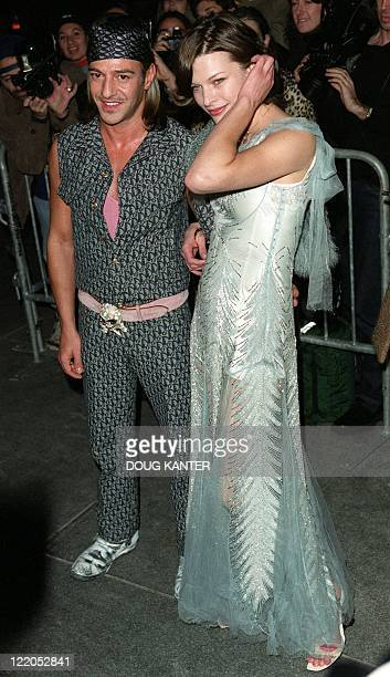 Designer John Galliano and actress Milla Jovovich arrive at the Christian Dior boutique in New York 04 December 1999 The event marked the opening of...