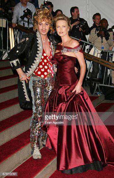 Designer John Galliano and Charlize Theron attend the Metropolitan Museum of Art Costume Institute Benefit Gala Anglomania at the Metropolitan Museum...