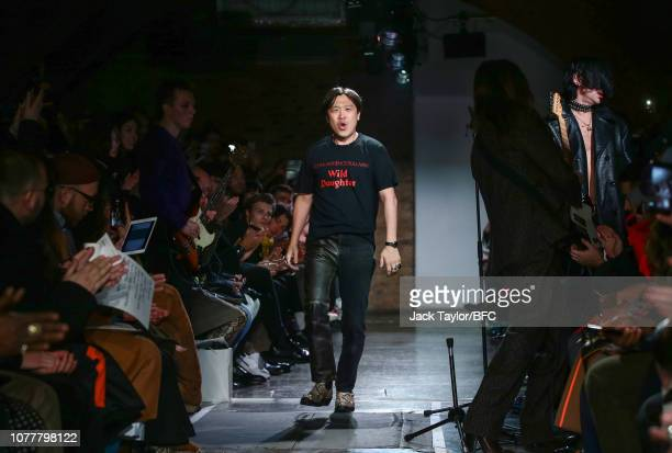 Designer John Lawrence Sullivan walks the runway at the John Lawrence Sullivan show during London Fashion Week Men's January 2019 at Kachette on...