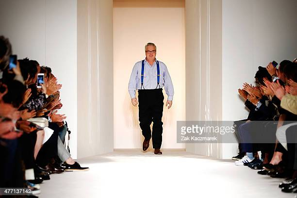 Designer John Ray is applauded on the runway at the dunhill show during The London Collections Men SS16 at Phillips Gallery on June 14 2015 in London...