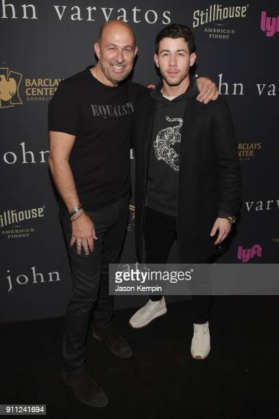 Designer John Varvatos and singersongwriter Nick Jonas attend the JVxNJ Launch Event at the Angel Orensanz Foundation on January 27 2018 in New York...