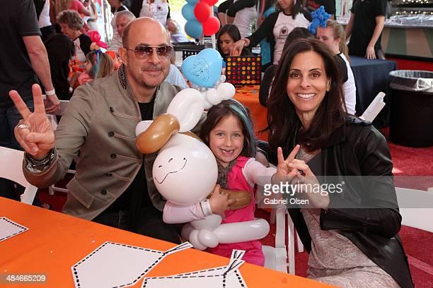 Designer John Varvatos daughter Thea Varvatos and wife Joyce Varvatos attend the John Varvatos 11th Annual Stuart House Benefit presented by Chrysler...