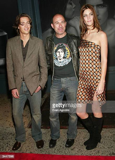 Designer John Varvatos poses with models Nick Brayant and Brigitte Swidrak during the John Varvatos New Fragrance For Men launch party at The Canal...