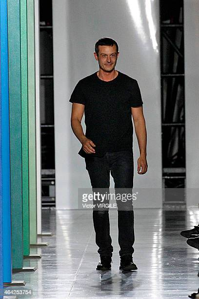 Designer Johnathan Saunders walks the runway at the Jonathan Saunders show during London Fashion Week Fall/Winter 2015/16 at TopShop Show Space on...