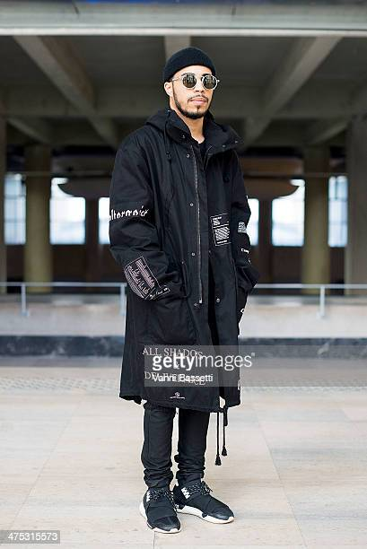 Designer Jonathan Briu wears a Raf Simons coat, Julius trousers and Y-3 shoes before Damir Doma show at the Palais de Tokyo on February 26, 2014 in...