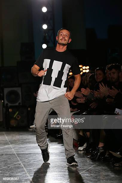 Designer Jonathan Saunders walks the runway to acknowledge the crowd at the Jonathan Saunders show at London Fashion Week AW14 at on February 16,...