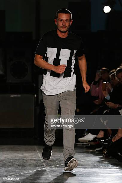 Designer Jonathan Saunders walks the runway to acknowledge the crowd at the Jonathan Saunders show at London Fashion Week AW14 at on February 16 2014...
