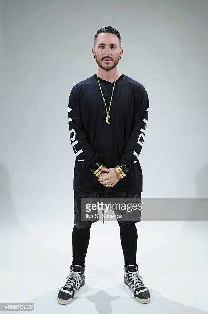 Designer Jonny Cota poses on teh runway at the Skingraft fashion show during Mercedes-Benz Fashion Week Fall 2014 at The Pavilion at Lincoln Center...