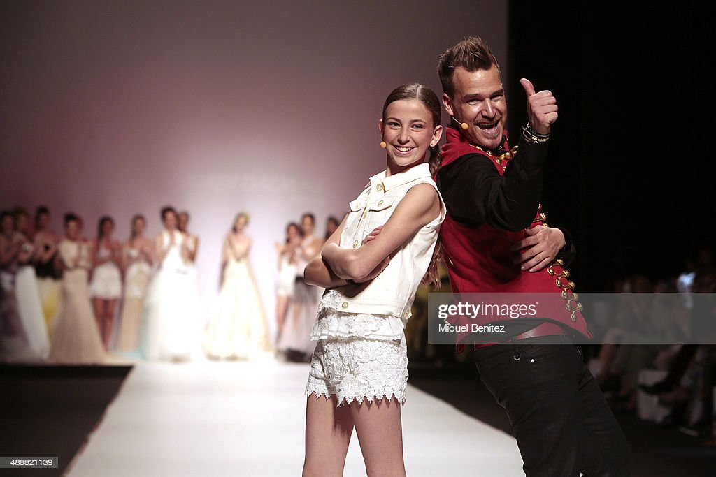 Designer Jordi Dalmau (R) walks the runway during the Jordi Dalmau fashion show as part of 'Barcelona Bridal Week 2014' on May 8, 2014 in Barcelona, Spain.